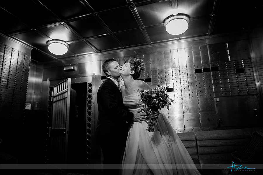 21C wedding day portrait of the bride and groom inside the bank vault located in Durham, NC