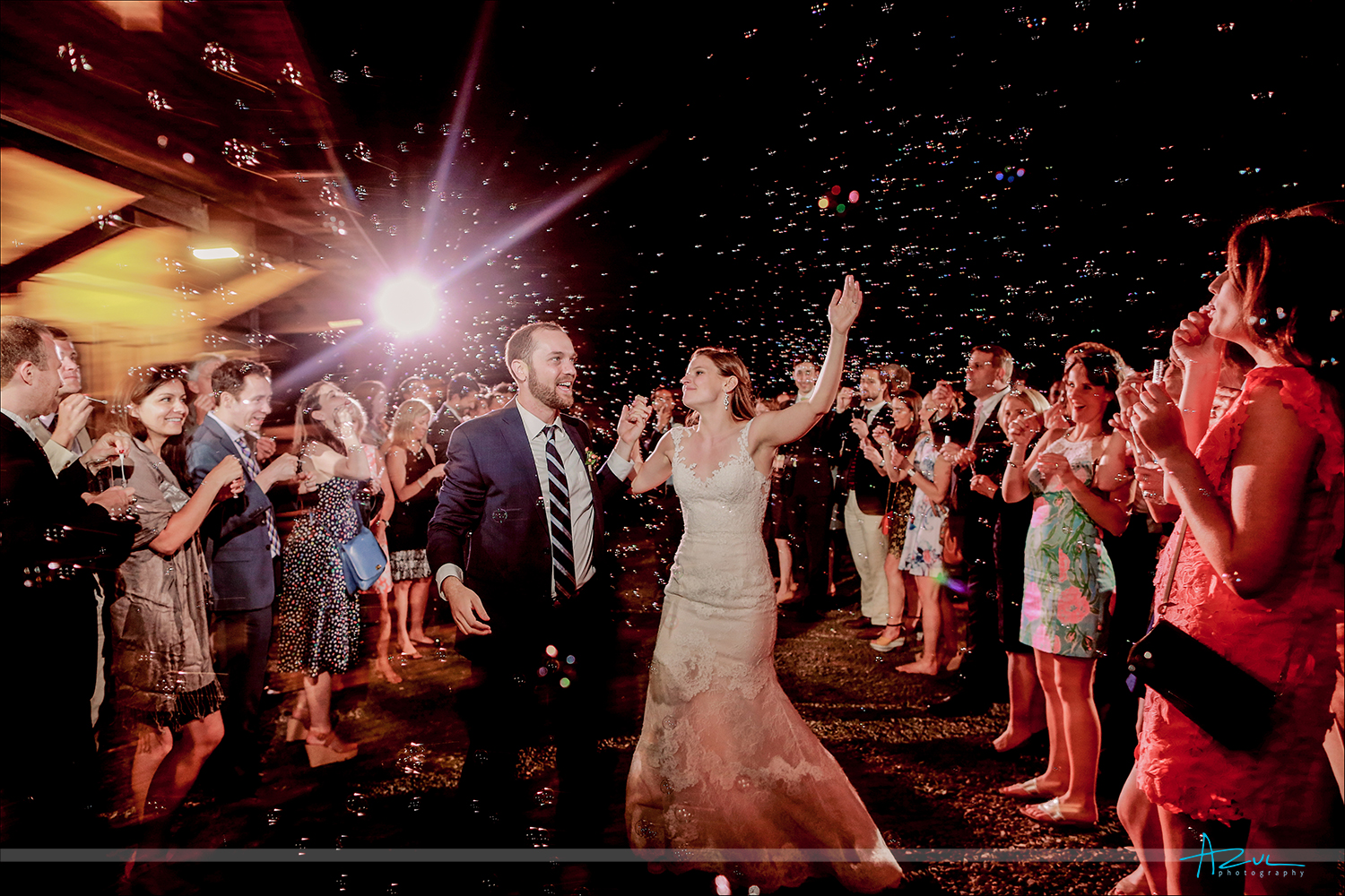 Wedding day bubble exit moment captured perfectly by the documentary photographer in Raleigh NC