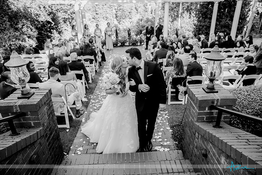 Sharing a kiss down the aisle is also a photographer favorite image to create in North Carolina.