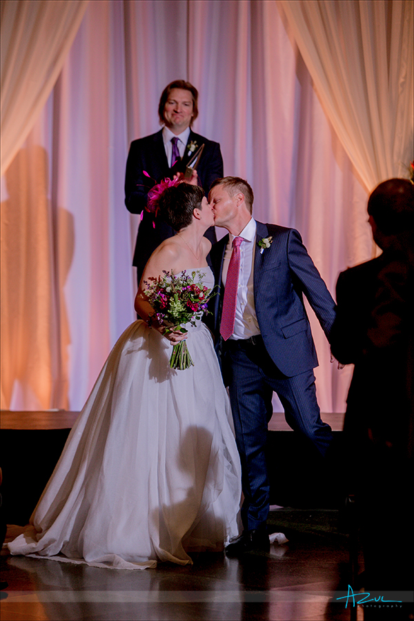 Wedding day ceremony kiss perfectly captured by the photographer at 21c in Durham