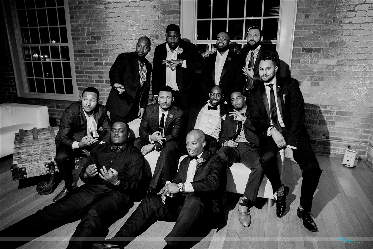 Group shots at a wedding are a must for wedding photographers at receptions while in The Cotton Room