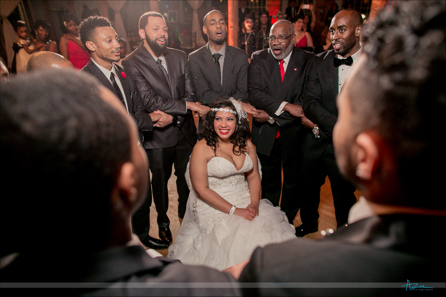 Fraternity tradition is to sing to the bride while at the reception located at The Cotton Room