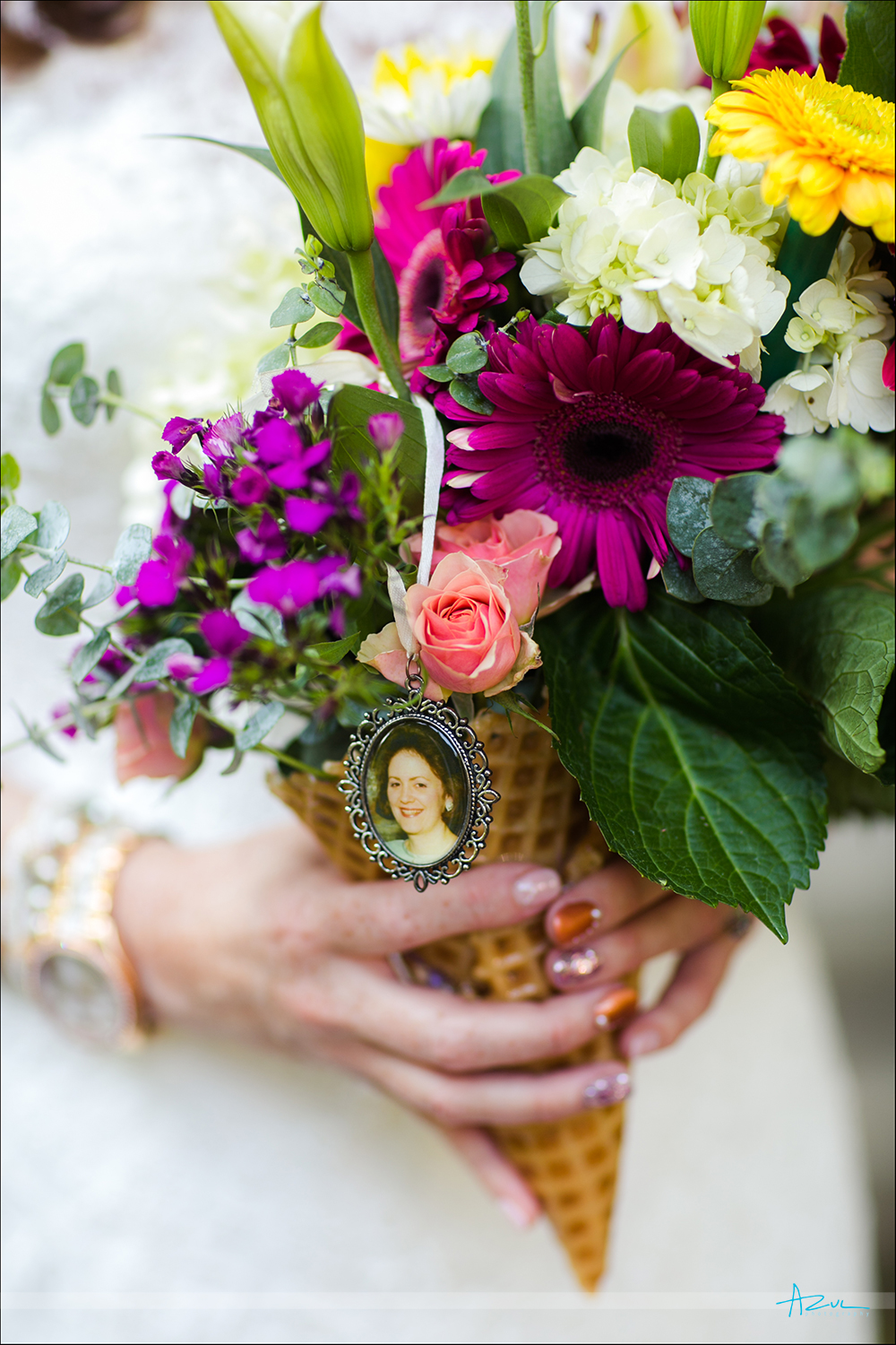 A bouguet with a photograph of mom keeps her memory alive during a wedding in Raleigh NC
