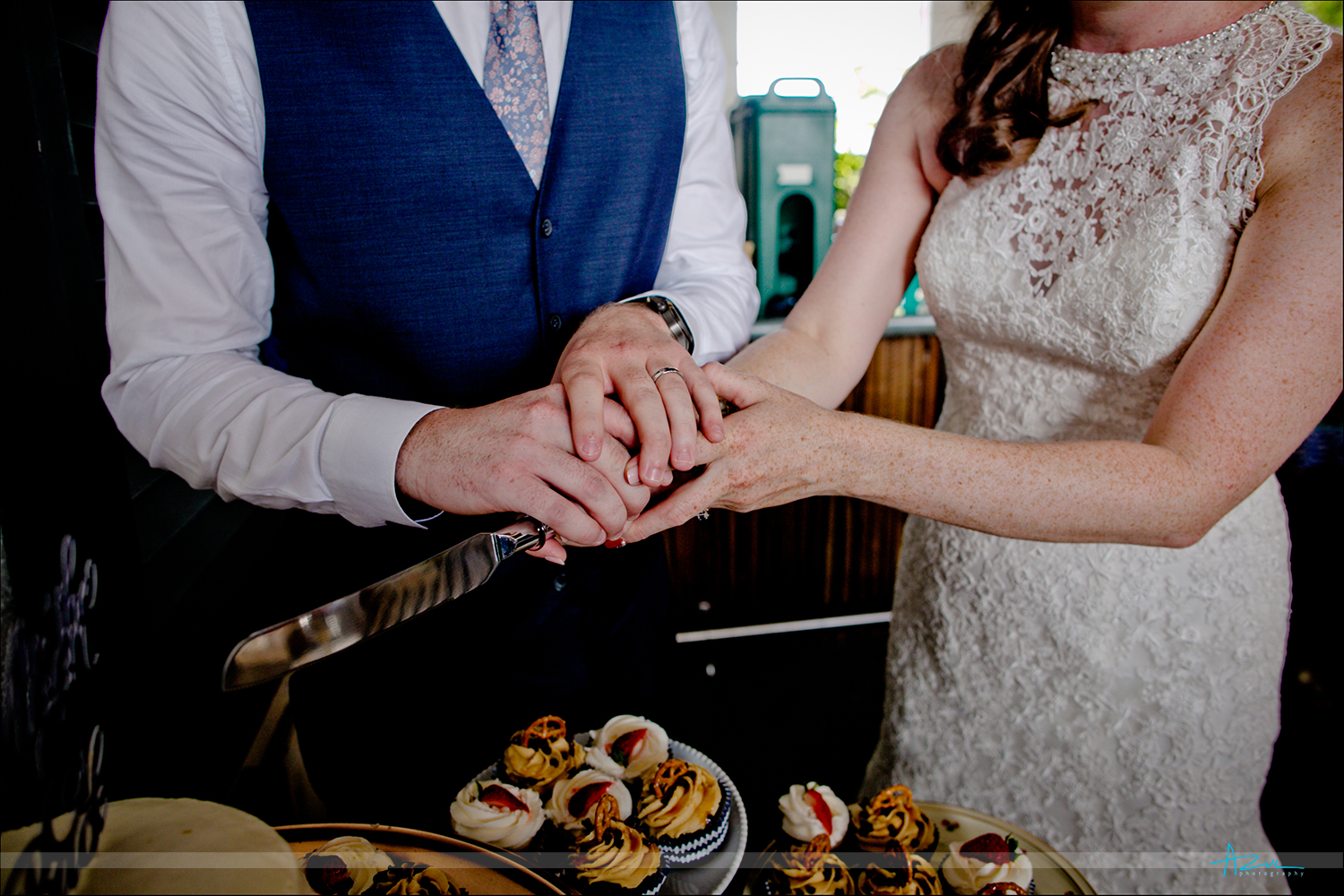Wonderful detail shot of hands cutting the cake with the B&G at the reception in Raleigh.