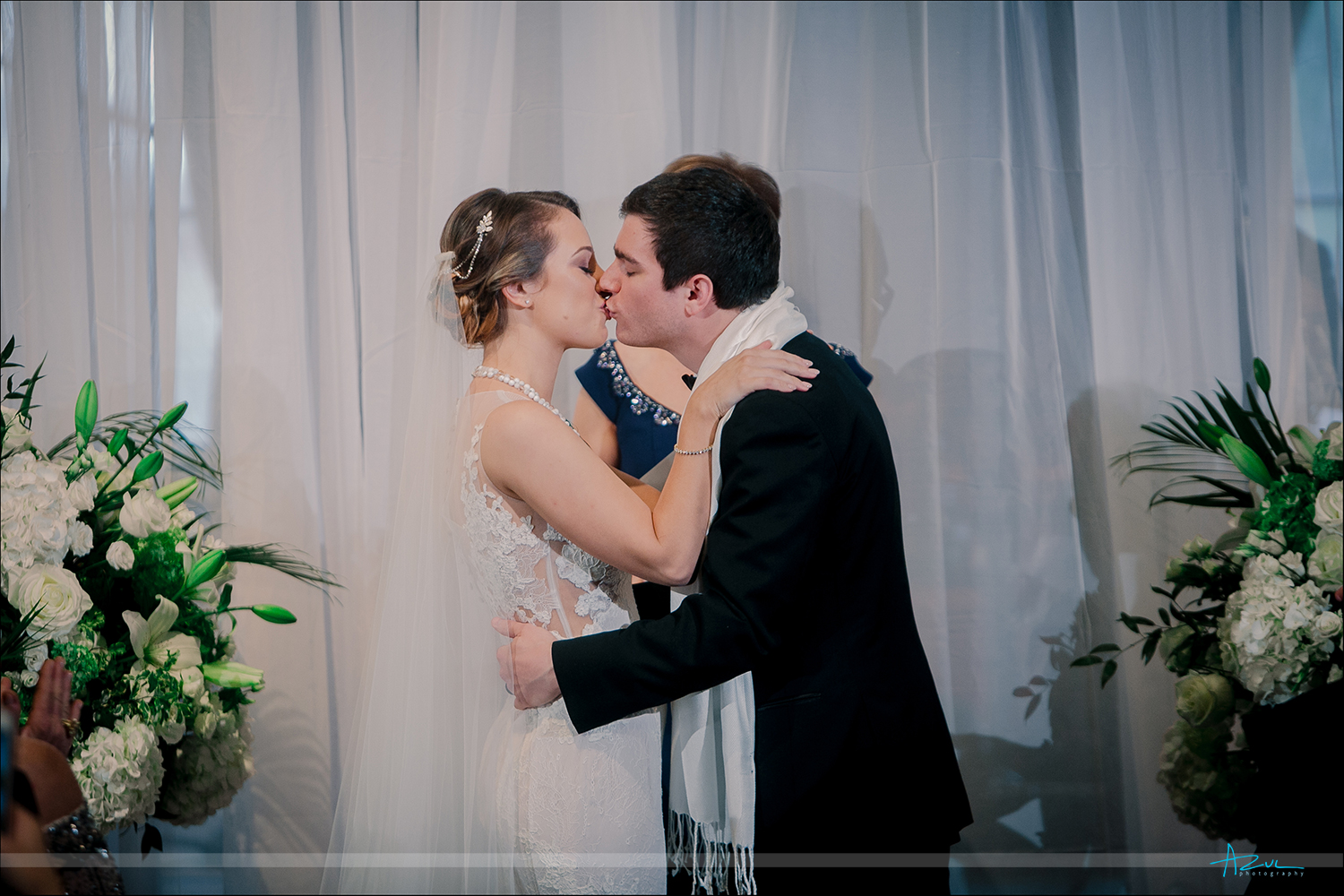 Wedding ceremony kiss of the bride and groom at 21c Museum & Hotel