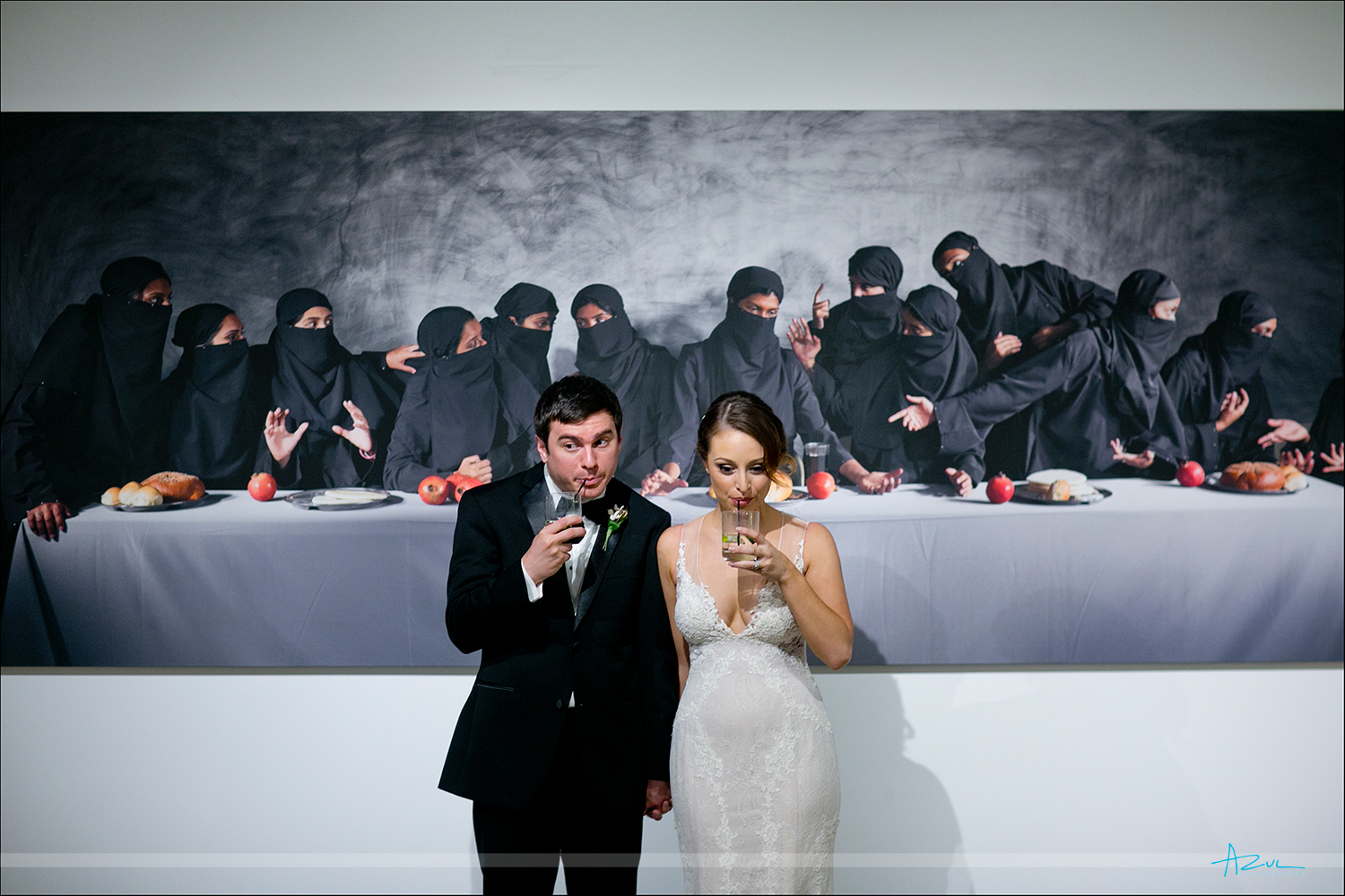 Fun wedding day B&G portrait with museum art while at 21c Museum & Hotel in Durham