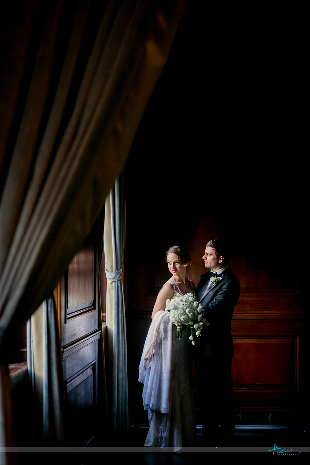 Window light portrait of bride and groom on the wedding day in Durham NC